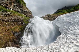Mount waterfall falling in snowfield