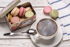 Coffee and macaroons in  box.