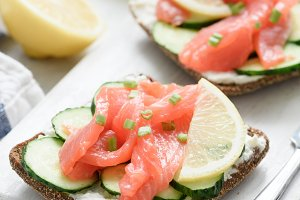 Appetizer salmon toasts on white