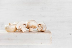 White champignons on the white table