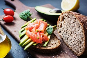 Rye toast with avocado and salmon