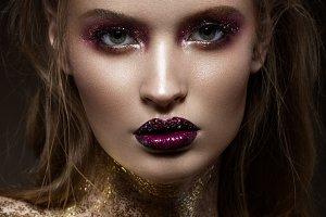 Beautiful girl with creative bright makeup with rhinestones . Beauty face.
