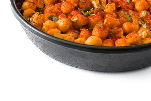 Fried spicy chickpeas in frying pan