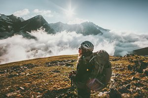 Backpacker woman observing mountains