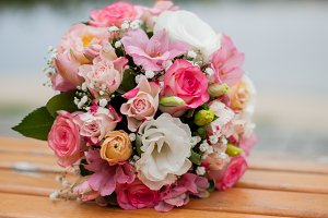 wedding bouquet of flowers lying on a bench, on a blurred background