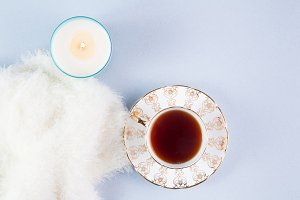 tea, candle and blanket