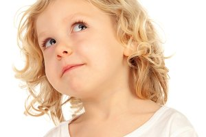 Pensive child looking up