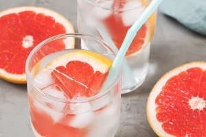 Cold drink with grapefruit and ice.