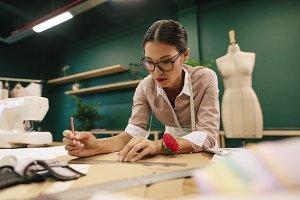 Dressmaker making a design draft