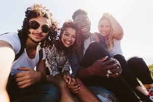 Smiling friends taking selfie