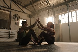 Couple exercising together at gym