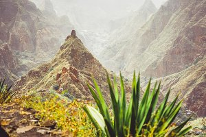 Mountain peak of Xo-xo valley and agaves plants on the trekking route down. Santo Antao island, Cape Verde