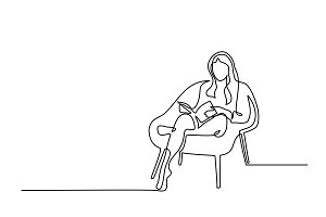 Woman sitting with book in chair