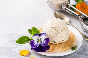 Vanilla ice cream with edible flowers