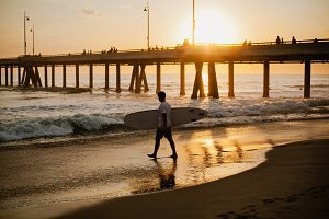 Surfer on sunset beach