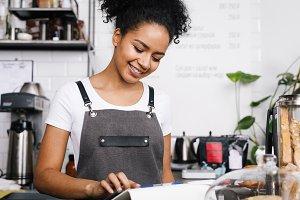 Smiling waitress using tablet