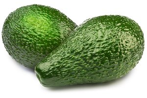 Two green avocados isolated