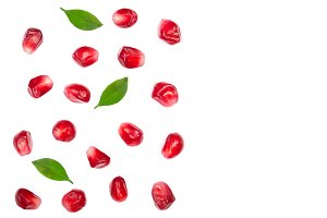 pomegranate seeds with leaves isolated on white background with copy space for your text. Top view. Flat lay pattern