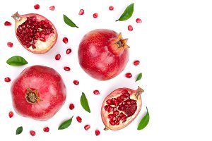 pomegranate with leaves isolated on white background with copy space for your text. Top view. Flat lay pattern