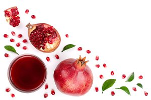 pomegranate juice with fresh pomegranate fruits isolated on white background with copy space for your text. Top view