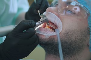 Stomatology clinic - patient male in dentistry chair