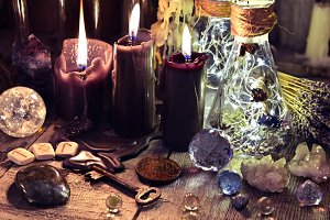 Three black candles and runes