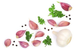 garlic with peppercorns and parsley isolated on white background with copy space for your text. Top view. Flat lay