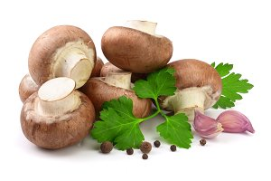 Royal Brown champignon with parsley, garlic and peppercorns isolated on white background
