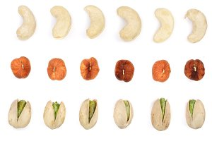 Mix nuts cashews hazelnuts pistachios isolated on white background. Top view. Flat lay