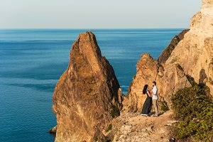 Guy and girl on the edge of a cliff