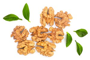 walnut kernels with leaves isolated on white background. Top view. Flat lay