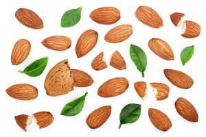 almonds with leaves isolated on white background. Top view. Flat lay pattern