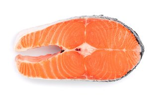 Slice of red fish salmon isolated on white background. Top view