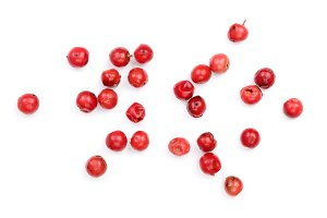 pink peppercorns seeds isolated on white background. Top view. Flat lay