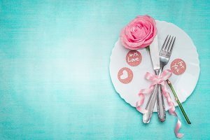 Romantic dinner table place setting
