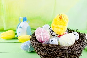Decorative toys eggs in the nest