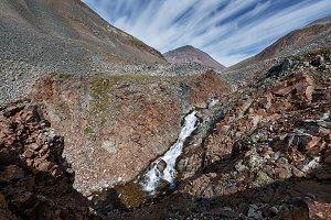 Mountain river into steep cliffs