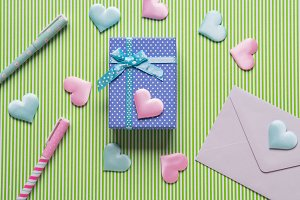 Blue gift box, hearts and envelope