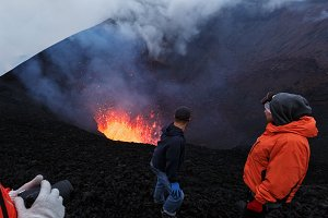 Tourists watching eruption volcano