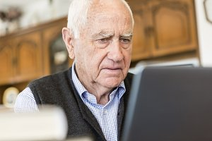 Senior man looking for information