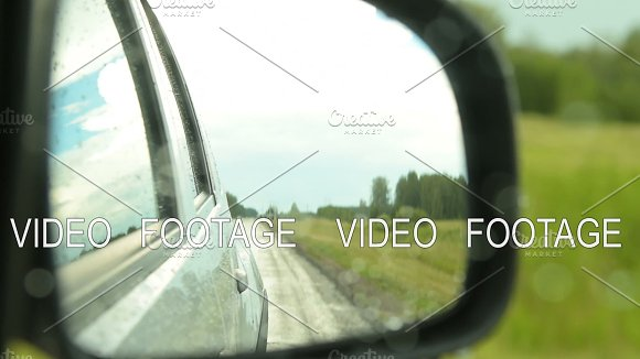Side-view Mirror Of Driving Car