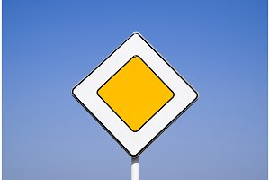 Road signs, the main road. Sign on a blue background