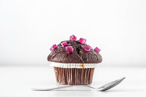 Muffin decorated with pink candies