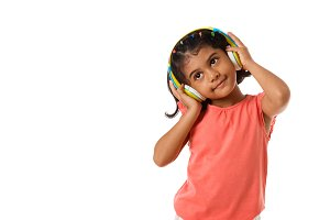 Child with headphones,isolated