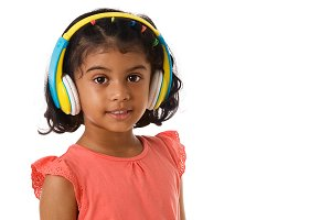 Child with headphones with copyspace