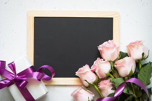 Pink rose present and chalkboard