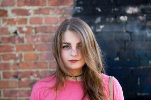portrait of a modern trendy girl tee