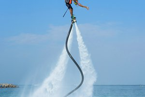 Father, daughter posing at flyboard