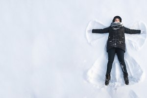 Girl in the snow angel shows . Winte