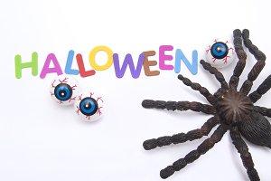 Tarantula and halloween eyes.